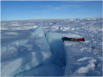 Marco Tedesco peers into a crack in the ice sheet (photo: Polar Seeds)