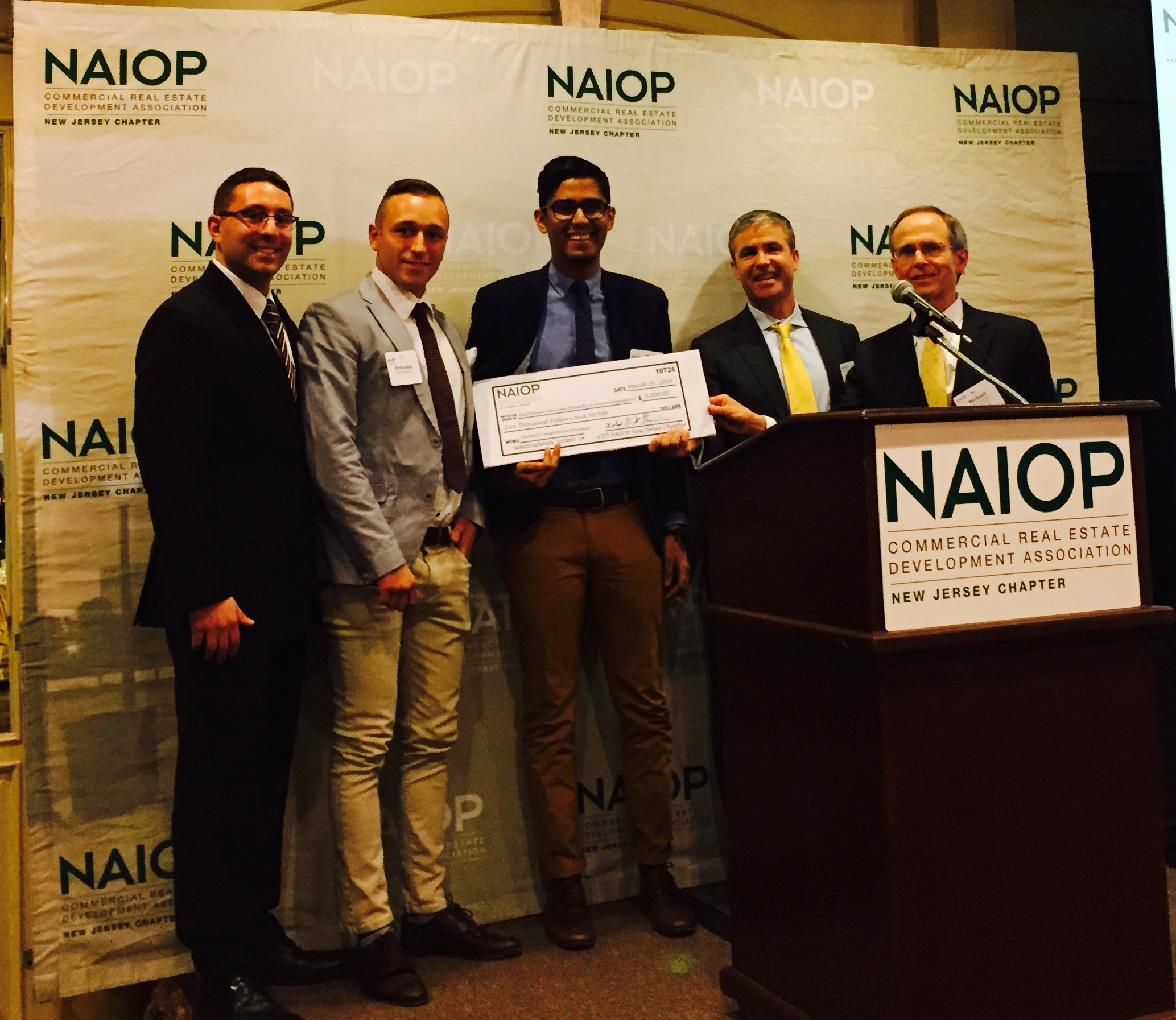 Dinosaurs to Diamonds Student Challenge winners Arturo Sangregorio, Newcome Edwards and Mark Bauer accept their $5,000 prize from NAIOP NJ VP Dave Gibbons (Elberon Development Group) and CEO Mike McGuinness (Photo courtesy NAIOP NJ)
