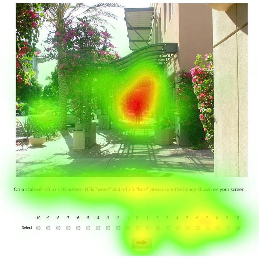 "A sample image showing the the area of interest of an image, or ""fixation time,"" represented visually in a heat map. The red areas indicate more time spent, ranging to green, where less time was spent on the image."