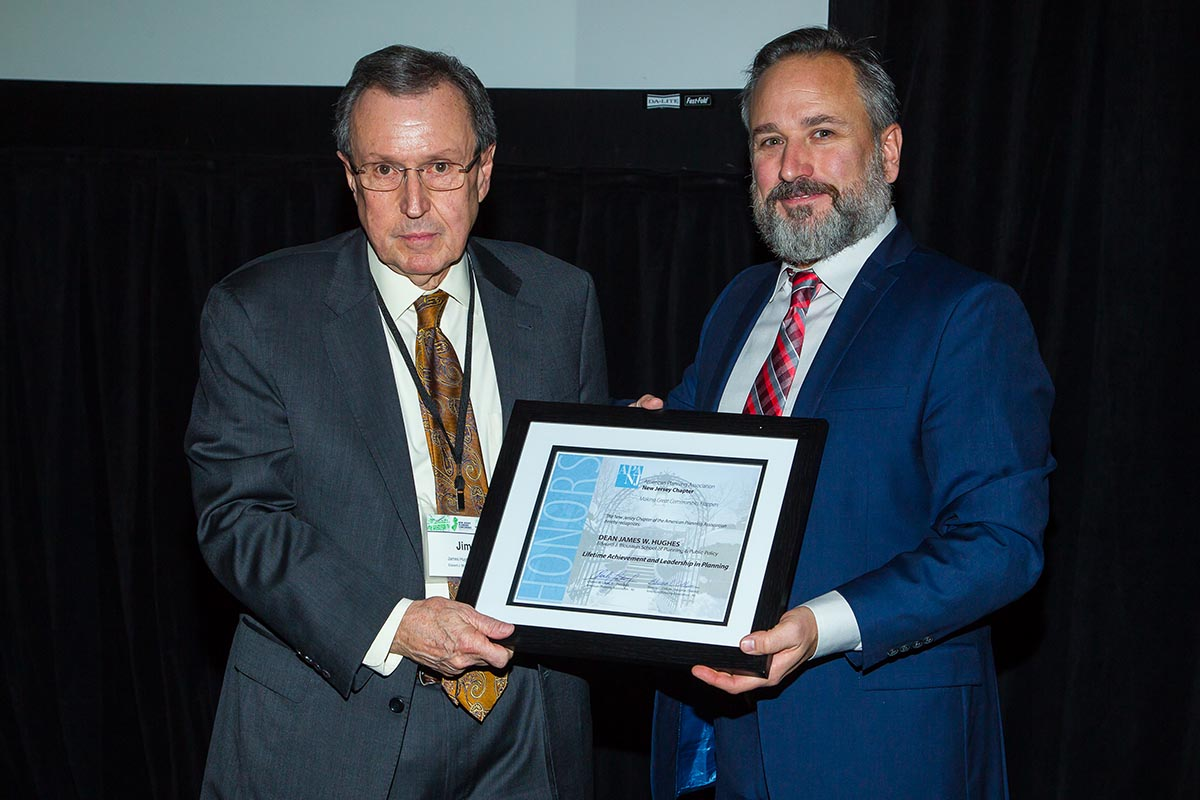 Charles Latini (right), President of the APA-NJ chapter, presents Dean James W. Hughes with the chapters Lifetime Achievement and Excellence in Planning award.